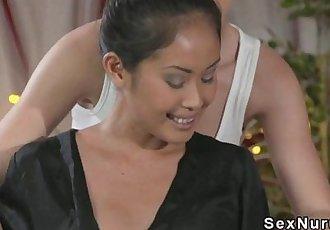 Blonde masseuse licks Asian babe - 10 min HD