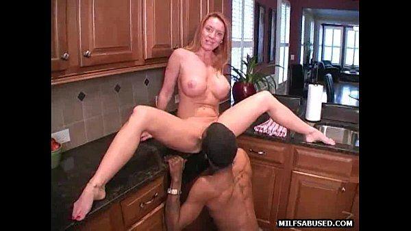 A sexy blonde milf is sucking a big black cock