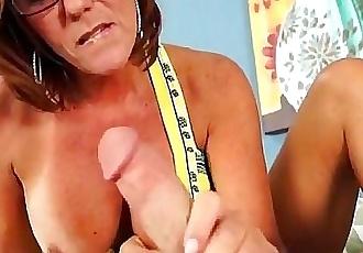 Horny milf strokes a fat cock 4 min