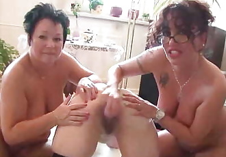 Three old lesbians having fun in the living room