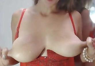 Lactating MILF pulls nipples and milks