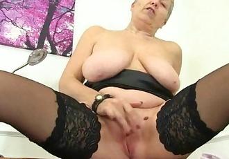 British granny Savana still loves a hot masturbation session in stockings