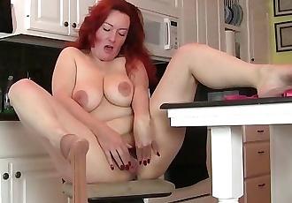 Pantyhosed milf Jessica OHare masturbates in kitchen