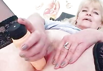 Older blonde mature shows off natural tits and latex cock skills