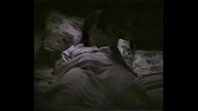 My horny mum fingering on bed reading a book. Hidden cam - 1 min 23 sec