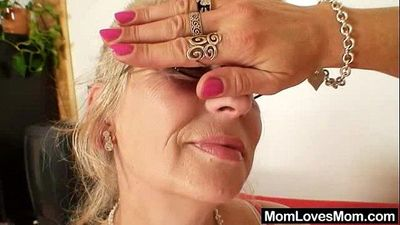 Well-endowed grandma penetrates a milf - 6 min
