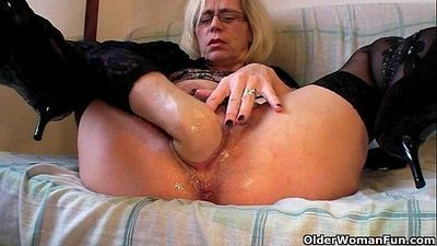 Slutty grandma in stockings fists her hairy cunt - 5 min HD