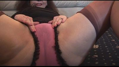 Busty mature with hairy pussy in mini skirt plays with panties and teases - 8 min