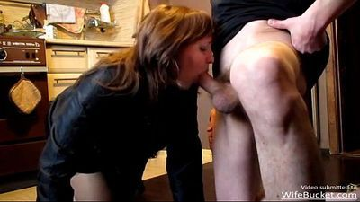 Real housewife giving a hot blowjob in the kitchen - 2 min