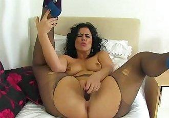 Spanish milf Montse Swinger dildo fucks nyloned cuntHD