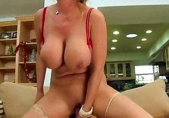Big titted milf in stockings rides cock for lucky guy