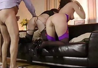 British MILF Lara Latex wearing stockings and high heels in FFM threesome