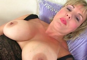 UK milf Danielle works her fuckable pussy with a massager