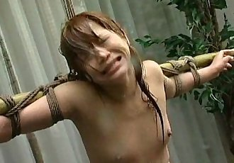 Tied up Asian babe soaked with a water hose - 8 min