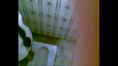 indian women peeing in toilet - 2 min