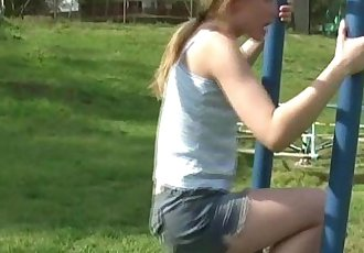 Young teen plays in the park and flashes her bodyHD
