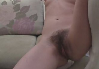 Sexy pale girl exposes her cute hairy pussy