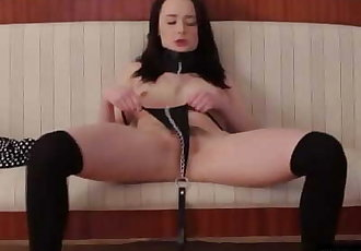 Pale beauty with collar and leash masturbating her hairy pussy