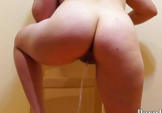 Russian girl with hairy by a pussy, pissing standing. Back view