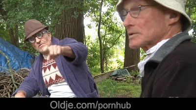 Old and young lustful threesome in the woods