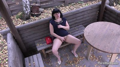 hidden camera. Brunette masturbating in a public place
