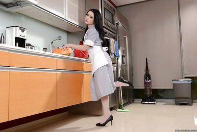 Maid Veruca James masturbates her tight vagina in the kitchen