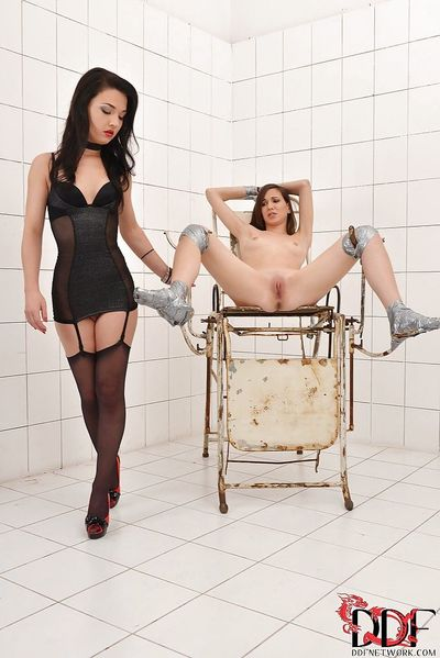Submissive lesbian has some BDSM pussy fisting fun with her mistress