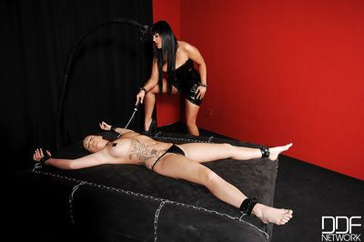 Lesbians Paige Delight & Jasmine Black engage in hard BDSM sex play in dungeon