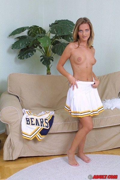 Naughty blonde cheerleader getting naked and exposing her goods