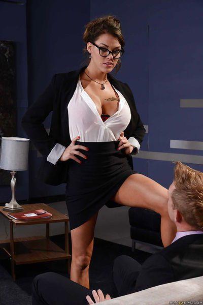 Glorious busty brunette Peta Jensen sucking a stiff cock in glasses