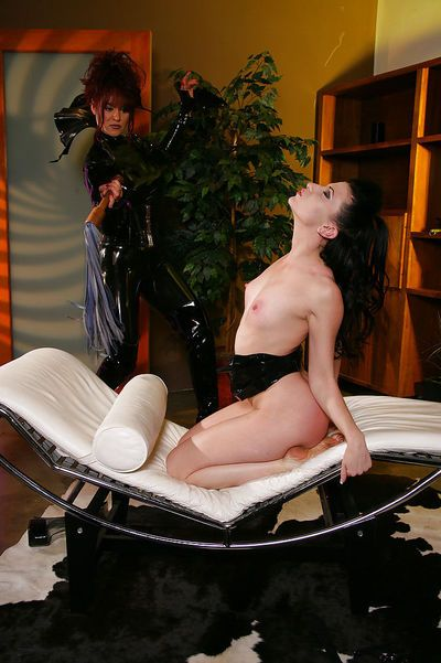 Lezdom ass whipping by latex attired lesbians engaged in BDSM sex scene - part 2