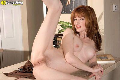 Middle aged housewife Lorelei Lane undressing for kitchen masturbation - part 2