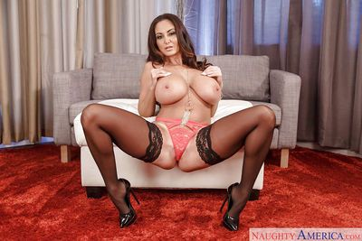 Busty wife Ava Addams takes selfies while dressing herself in lingerie & skirt