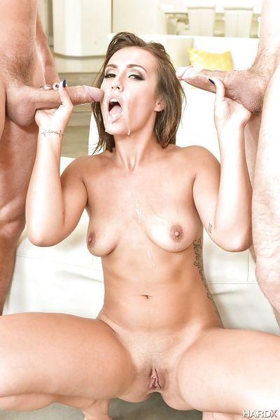 Pornstar Kelsi Monroe giving two fat cocks a blowjob at same time - part 2