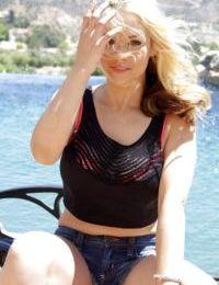 Outdoor posing session with a slender pornstar blonde Sarah Vandella