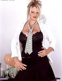 Hot MILF Kelly Kay shows off her nice melons on top of her office desk