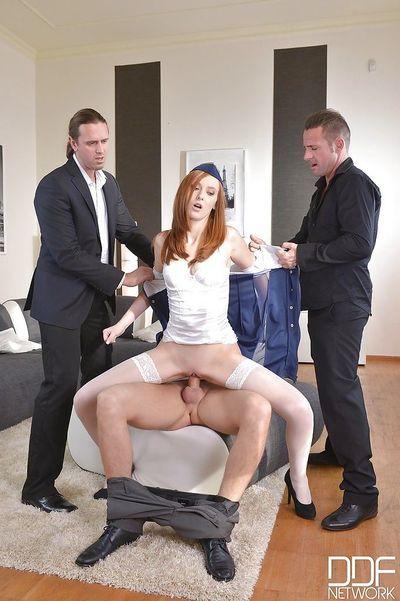 Naughty redhead stewardess Linda Sweet sucking and riding cock in gangbang