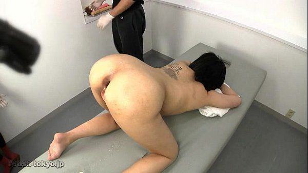 Japanese girl gets anal fisted for half an hour on a table