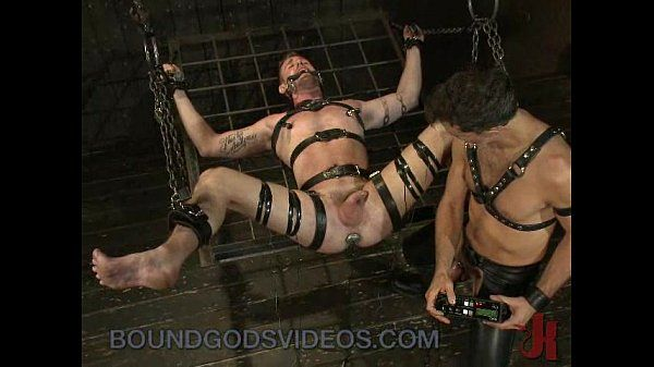 Tied up gay to a bondage ladder gets his dick slapped