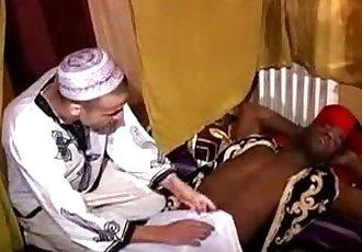 A top black guy is fucking a bottom arab boy !