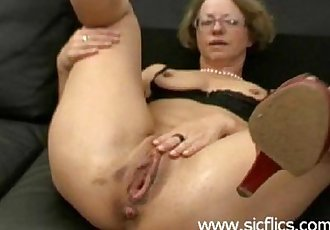 Mature slut gets brutally fist fucked in her loose pussy by two merciless brutes - 5 min