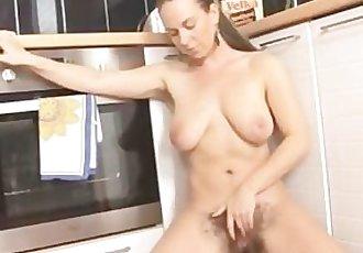Erin Eden fingers her hairy pussy