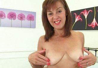 British gilf Georgie Nylons fingers her arse
